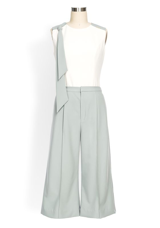 Sage and white two-piece culotte suit with sleeveless tie drape top