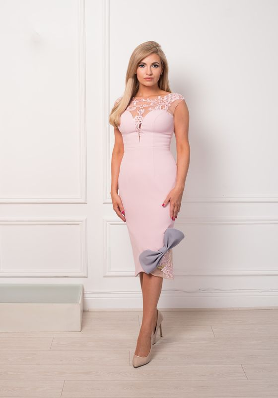 Pale pink pencil dress with sweetheart neckline, lace embroidery and contrast bow hem