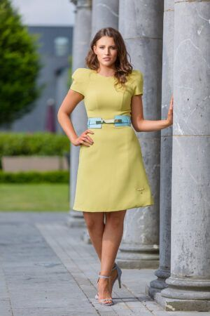 Lime green a-line dress with dramatic padded shoulder