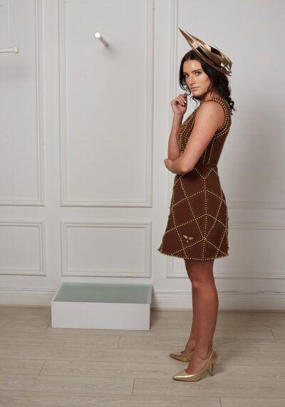 Model wearing Phoenix V Melissa ALine occasion dress, side view