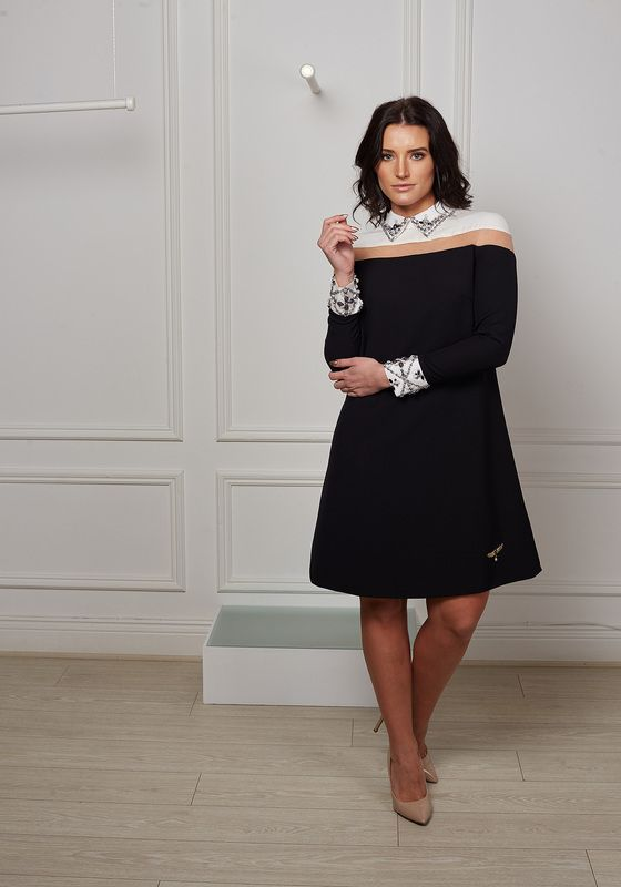Black shift dress with white shirt collar and cuff embellished with silver jewels