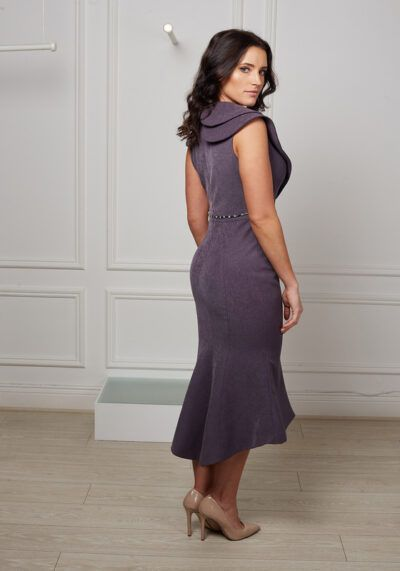 Model wearing Phoenix V Cabria fishtail occasion dress, side view