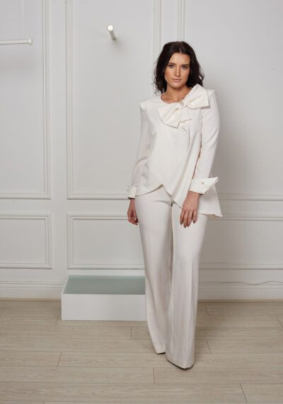 Ivory flowing blouse with pearl bow and cuff and wide leg trousers