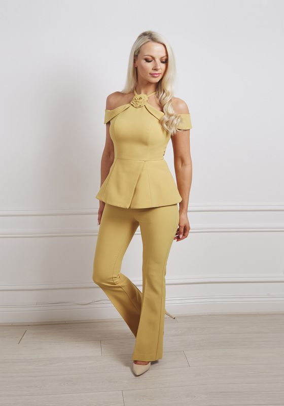 Mustard cold-shoulder peplum suit with rosette at the neck and wide leg trousers