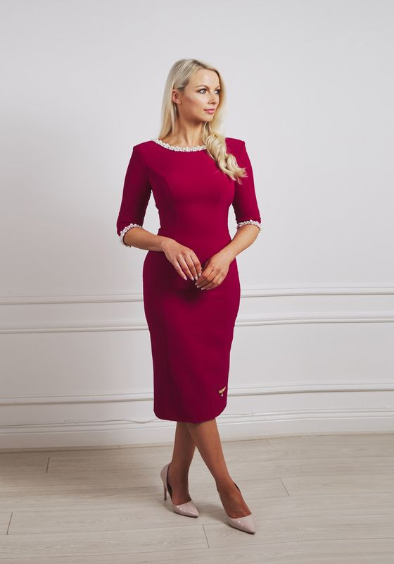 Raspberry pencil dress with shoulder pad and ivory pearl neckline and cuff