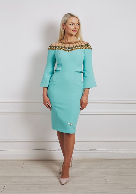 Mint green pencil dress with gold beaded illusion neckline, bell sleeved and pocket detail