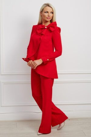 Red suit with oversized bow and pearl detailing with flare trousers