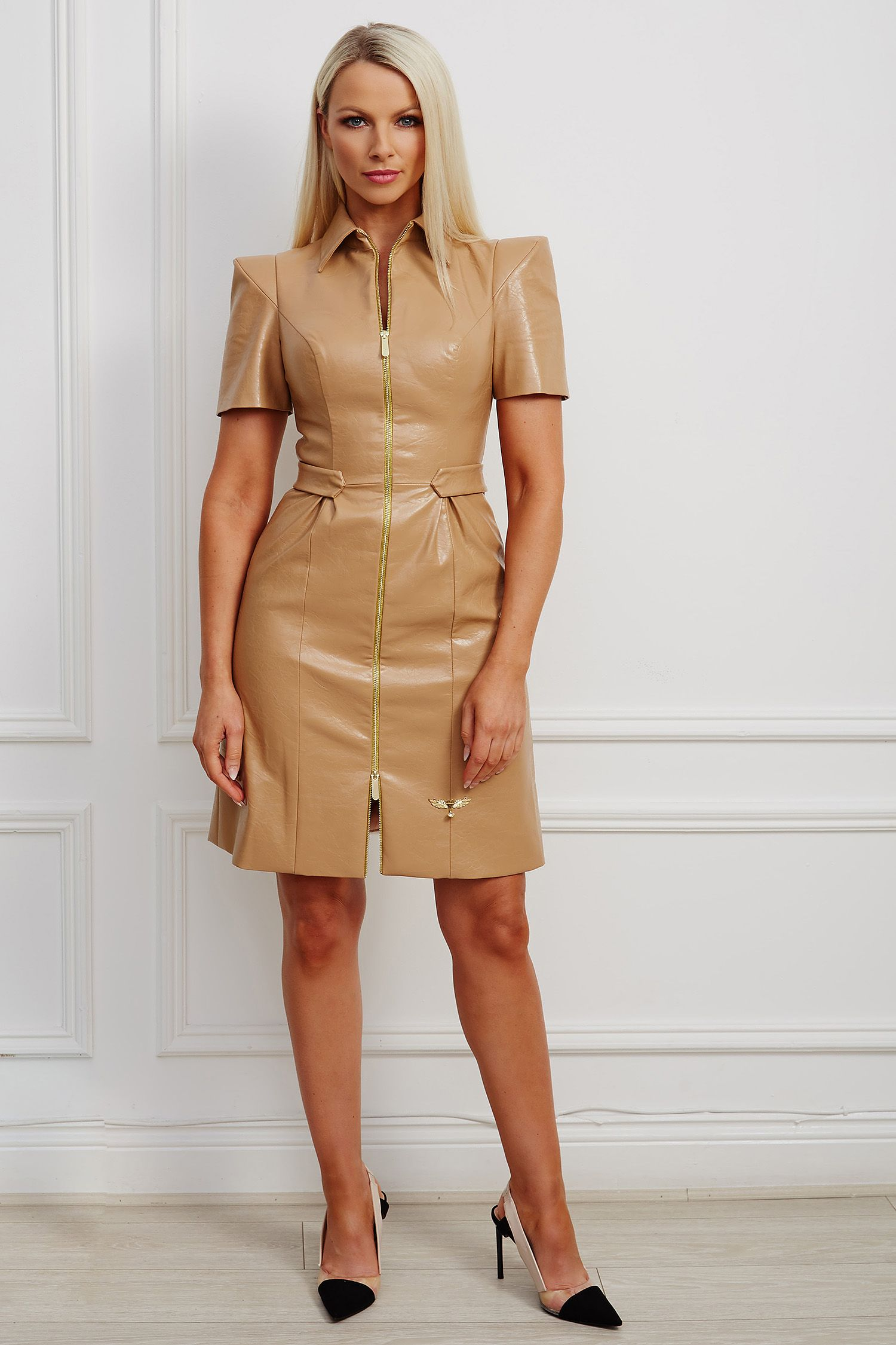Tan faux-leather mini dress with structured shoulder and gold hardware