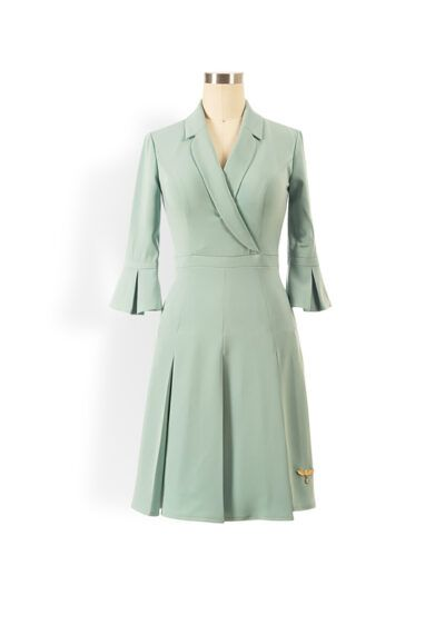 Sage green a-line blazer dress with a box-pleated mini skirt and three-quarter length sleeves