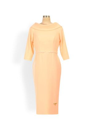 Peach cowl neck and back pencil dress with three-quarter sleeve and ivory pearl detailing at the waist