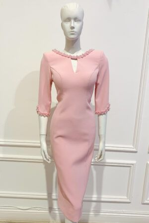 Pale pink pencil dress with pink pearl beading on the neckline and cuffs. V cutout in neckline and cuff and scoop back