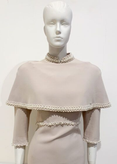 Taupe cropped high neck cape with pearl trim