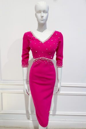 Cerise v-neck empire waist pencil dress with three quarter length sleeves and ivory pearl embellishment