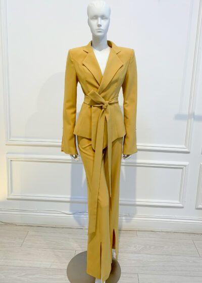 Mustard two-piece suit with slit hem jacket and trousers and tie belt