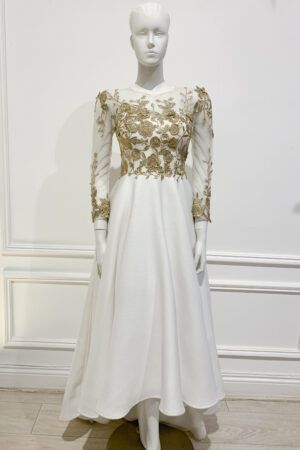 White high-low a-line gown with gold lace top and long sleeves