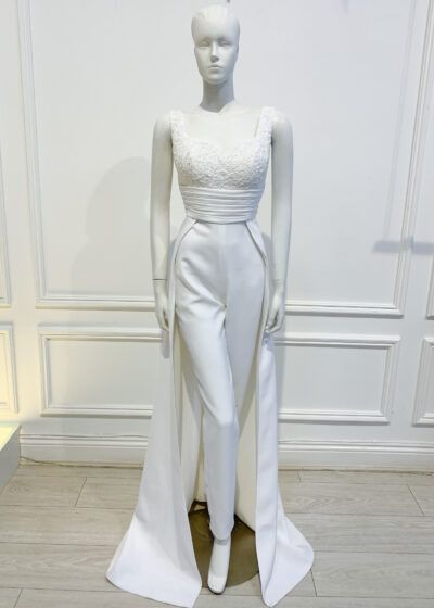 White sweetheart neckline sleeveless jumpsuit gown with lace top and wide belt