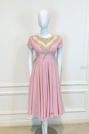 Pale pink pleated A-line skirt with elaborate pearl and jewel embellishment and cape sleeve