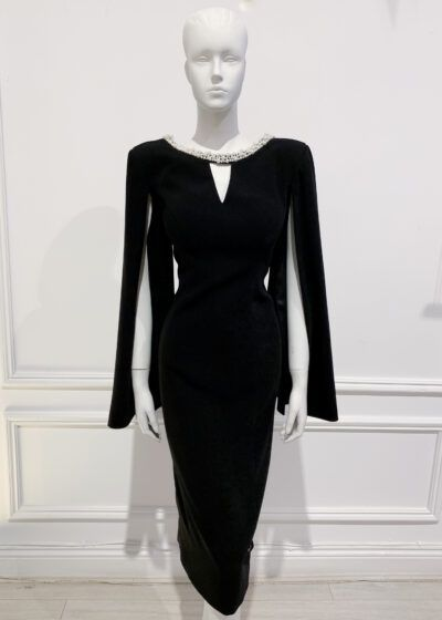 Black cape sleeve dress with v cutout and pearl neckline