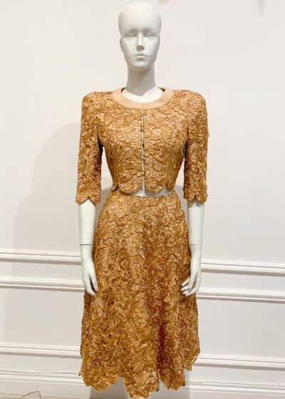 Gold lace two piece suit with jacket and a-line skirt