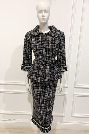 Black and white tweed peplum suit with skirt and pearl detailing