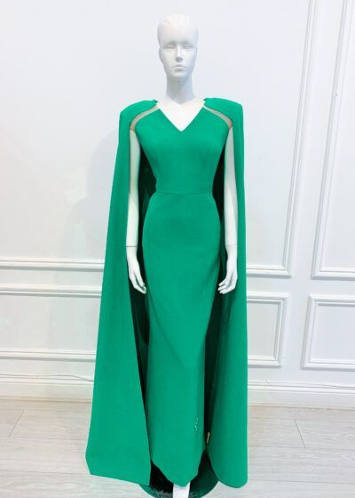 Green column gown with v, neck, full length cape and shoulder pads