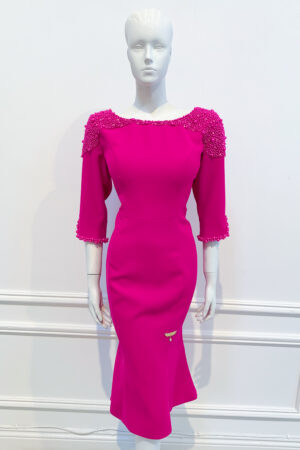 Long sleeved boat neck high-low fishtail with scoop back and cerise pearl embellishment