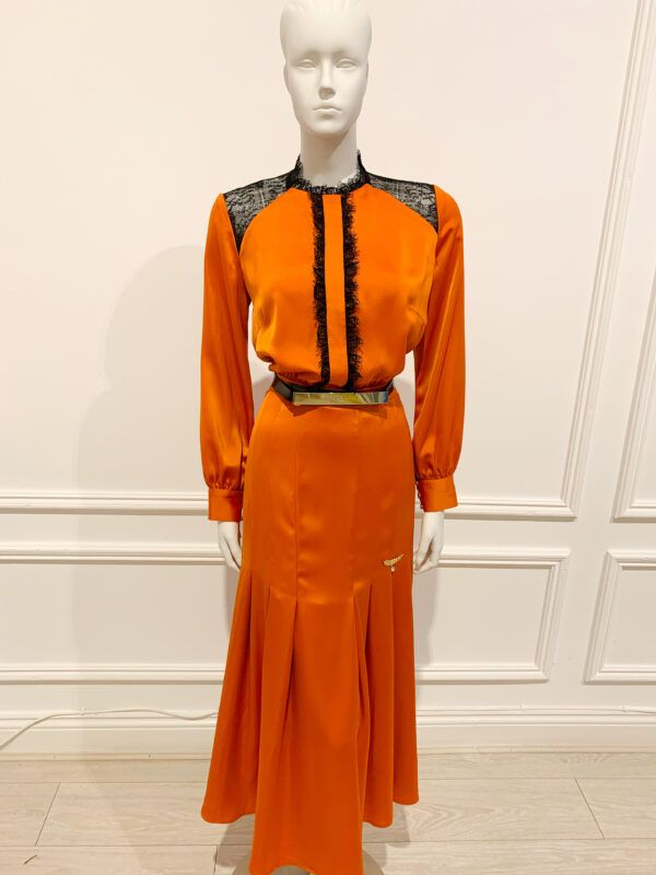 Aoine burnt orange satin midaxi dress with pleated skirt, black eyelash lace detailing and gold buttons
