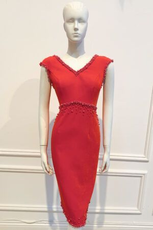 Bright red sleeveless empire waist v-neck pencil dress with red pearl embellishment