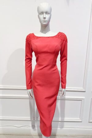 Coral long sleeved pencil dress with boat neck an low back and glass bead embellishment