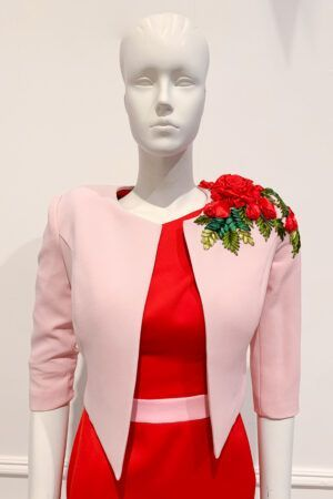 Pale pink cropped bolero jacket with red rose ribbon detail on shoulder