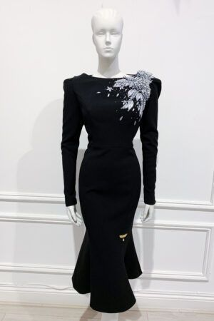 Black long sleeved fishtail with structured shoulder and silver ribbon embellishment
