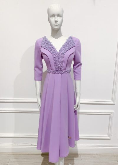 Lilac pleated a-line with beaded collar, v-neck and elbow length sleeves