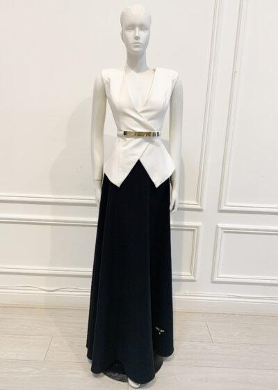 White wrap sleeveless jacket with black full-length a-line skirt
