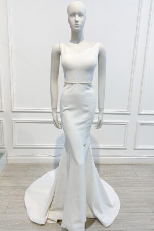 Ivory sweetheart neckline fishtail gown with straps and illusion pearl waist beading