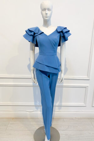 Cornflower blue straight-leg trouser with matching double peplum top with dramatic ruffle shoulder