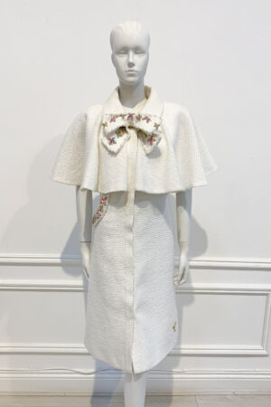 Ivory tweed cape dress coat with pink jewelled bow