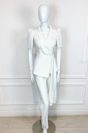 Ivory tuxedo style peplum trouser suit with satin sash and puff shoulder