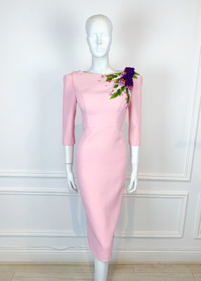 Pale pink pencil dress with structured shoulder and floral ribbon detail on the shoulder