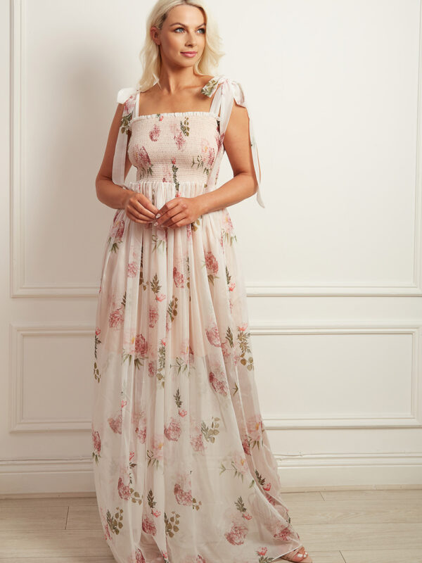 White printed chiffon maxi dress with tie shoulder straps and a shirred bodice