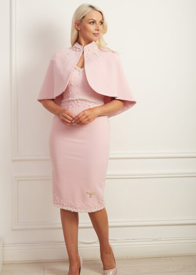 pale pink dress and cape with pearls