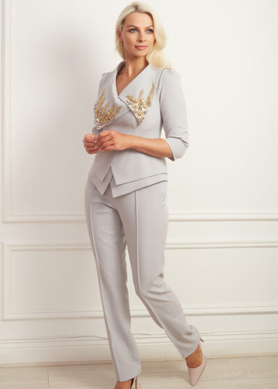 Grey double peplum suit with oversized collar and elaborate gold beading
