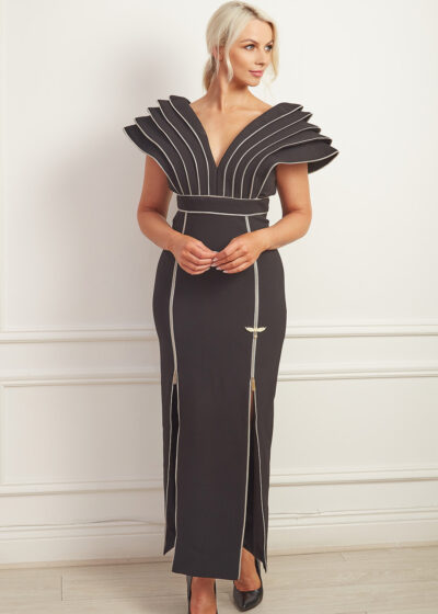 Black column gown with dramatic shoulders and silver zip detailing