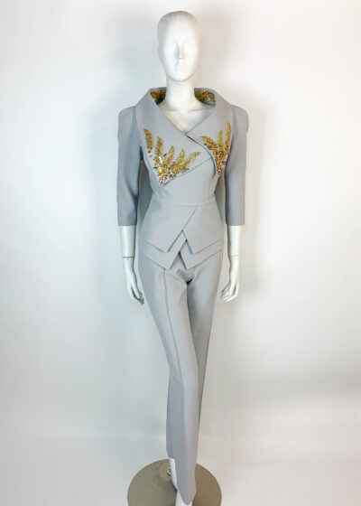 Grey trouser suit with peplum and elaborate gold embellished collar
