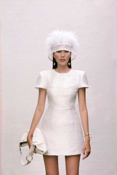 White cap sleeve textured mini dress with heart detail