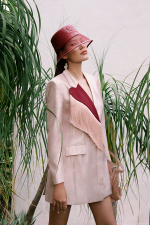 Pale pink blazer with contrast collar and fringe detailing