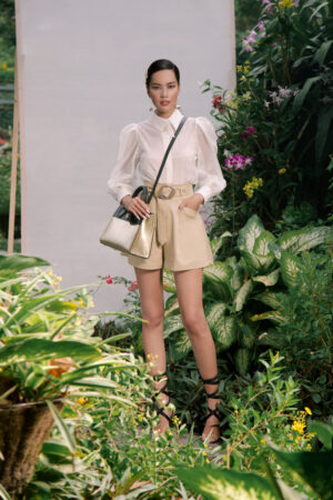 Beige pleated paper bag shorts
