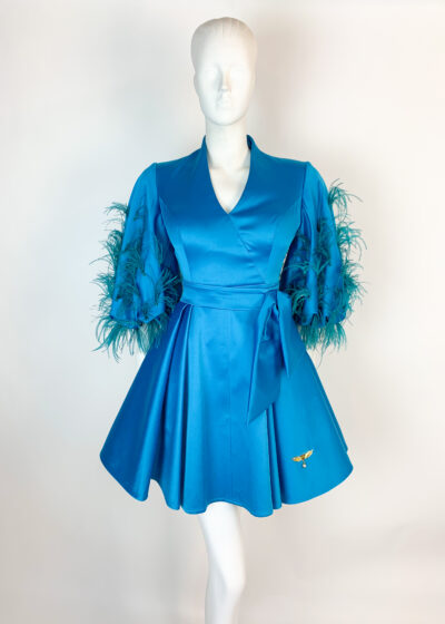 Turquoise satin pleated a-line dress with feathered puff sleeves and bow at waist