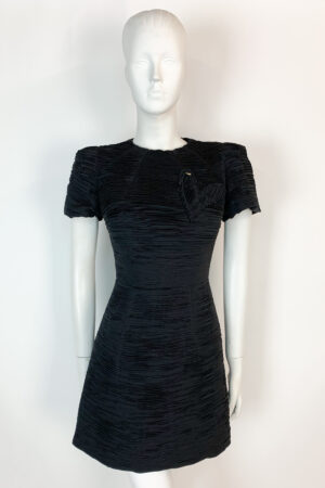 Black textured mini dress with cap sleeve and heart detail