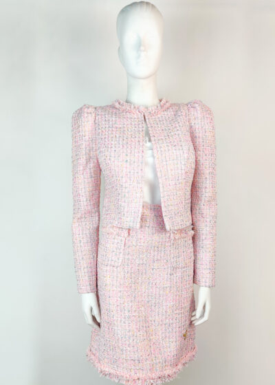 Pale pink tweed suit with cropped jacket and mini skirt