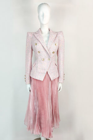Pale pink tweed double breasted blazer with pointed shoulder and knife-pleated iridescent midi skirt